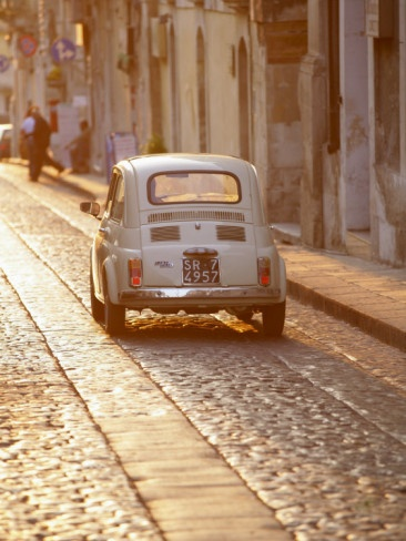 Fiat 500 Driving Down Cobbled Street, Noto, Sicily, Italy