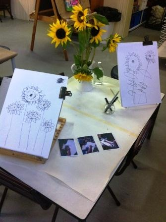 Great display of still life drawings. Teachers need to be intentional in what they display to inspire learning.