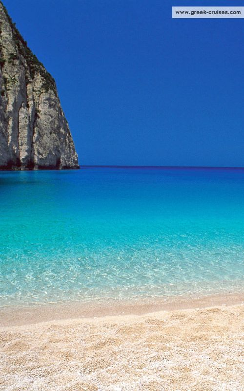 Navagio beach, Zakynthos island ~ Greece I remember visiting this beach, it is stunning. It really is that clear.