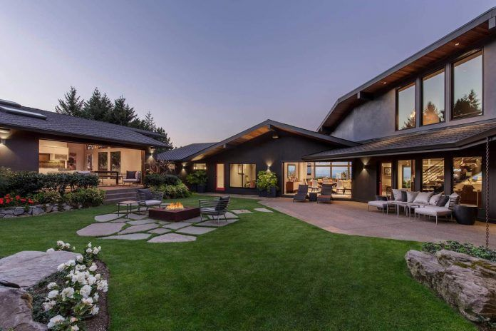Modern dormer with a low sweeping roof that opens up to an amazing view of Portland - CAANdesign