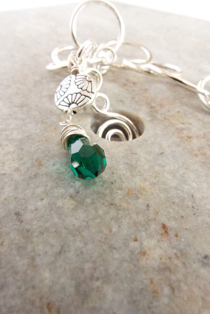 A personal favourite from my Etsy shop https://www.etsy.com/au/listing/254300372/silver-circle-bracelet-green-swarovski