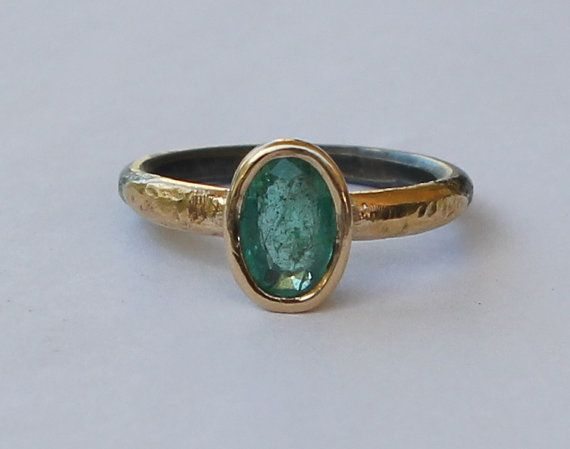Size 7.5 hammer forged sterling silver ring. The stone is a high quality natural 1.25 ct medium dark green Columbian emerald (panna stone). The