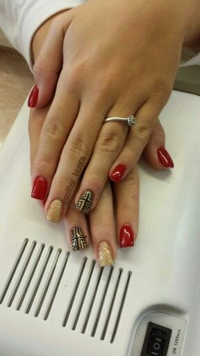Gold and red nails with accent nail