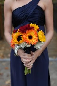 I think I might prefer this color for the bridesmaid dresses and I actually really the sunflowers for a bouquet.