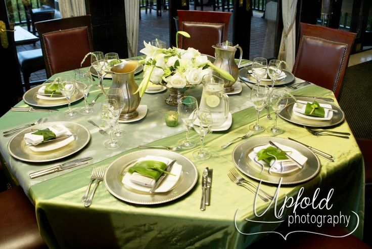 This stunning Vintage Silver and Green wedding table decor was shot at a wedding at Zimbali Lodge, South Africa. We just loved the idea of the palm leaves used as napkin holders. Image by Upfold Photography, Auckland. ~ Vintage weddings ~ Green and Silver wedding decor ~
