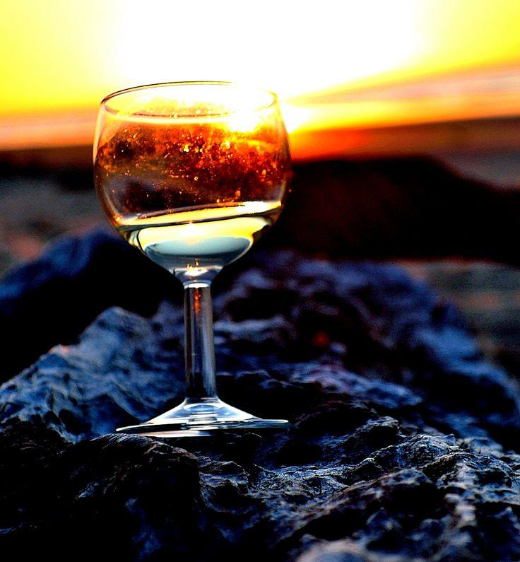 Sunset through a wine glass, taken at Ohiwa beach