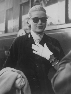 Grace Kelly captured by Edward Quinn. Kelly loved travelling by train. Pic via http://www.michaelhoppengallery.com