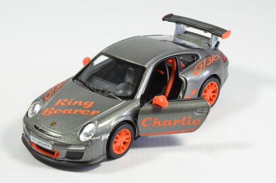 Fantastic little model Porsche cars that you can personalise to make a unique gift for your pageboy or ring bearer. You can add any name to the drivers door and their wedding duty to the bonnet (hood)  There is a choice of different colours; black, white, orange or metallic grey (all subject to availability).  The cars are die cast and plastic with opening doors and pull back action. Although the models are, obviously, mass produced the personalisation is all applied by hand.  Please note…