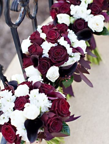 Favorite. Burgundy amaryllis bouquet for bride. Maids get solid color, maids of honor get mixed.  Could somehow mesh with candle-rose centerpiece?