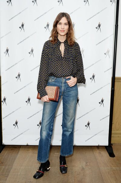 9f462dcfd83 Alexa Chung Bootcut Jeans - Alexa Chung contrasted her modest blouse with  edgy bootcut jeans.