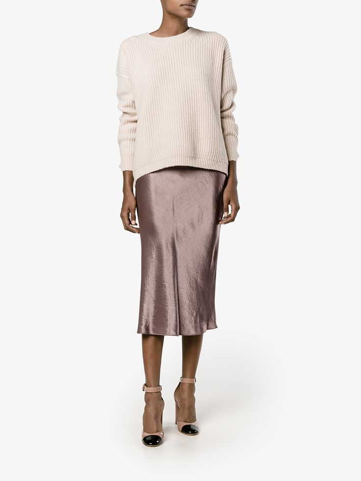 This coffee Vince flared satin midi skirt is going to be of excellent service to you my friends, come rain or shine. Designed for the brand's layering-focused AW 16 collection, this skirt has been fabricated from a lustrous coffee satin fabric and features a high waist, A-line shape and midi length. We recommend teaming your Vince skirt with a Saint Laurent t-shirt and Gianvito Rossi two tone pumps for an effortlessly cool dinner ensemble.