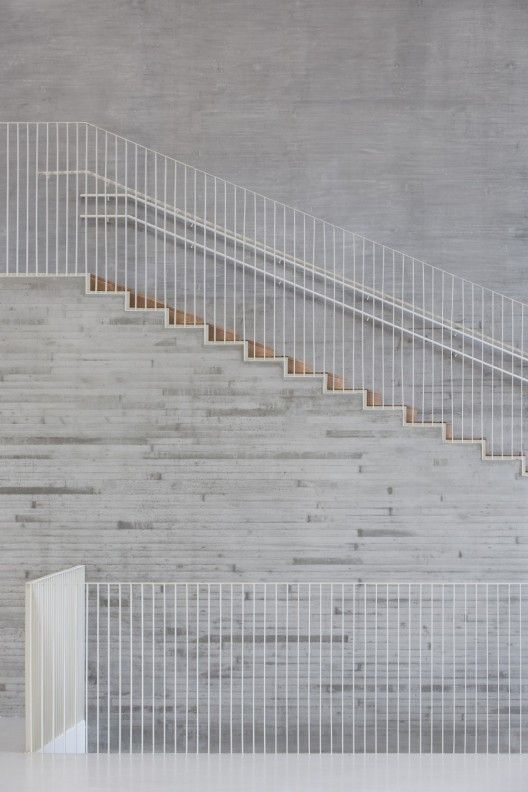 Concrete, timber, fine steel balustrade - Saunalahti School, VERSTAS Architects © Andreas Meichsner, Espoo Finland