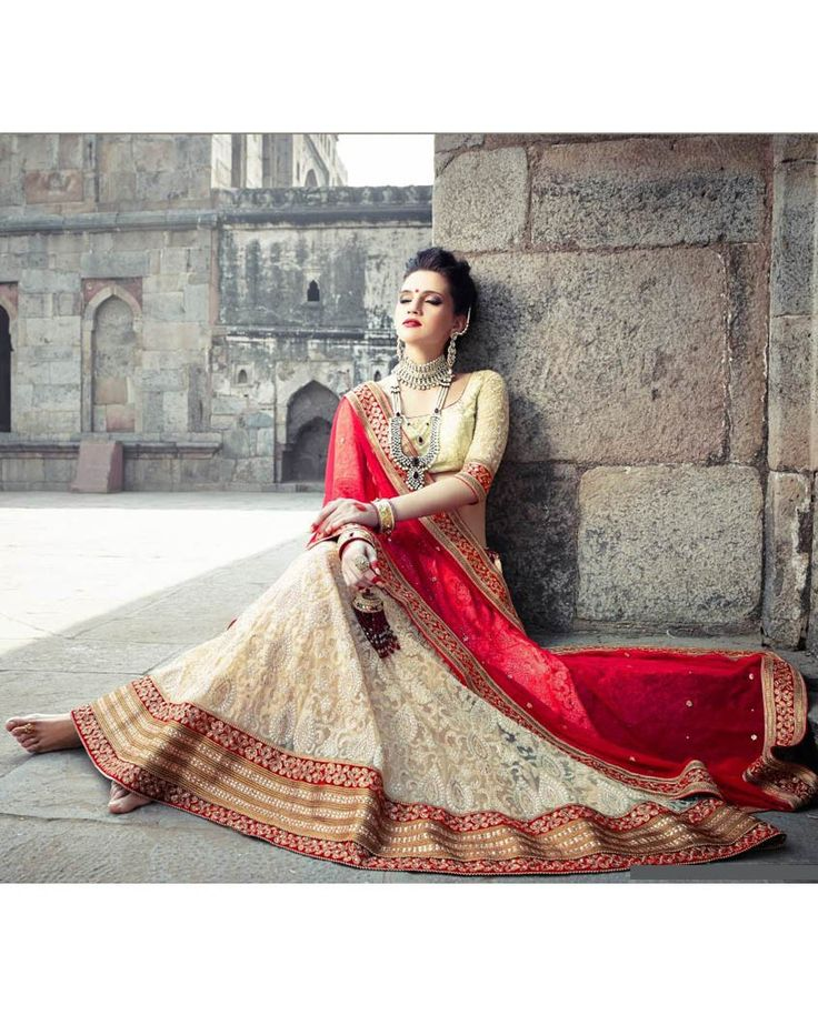 Beige embroidered lehenga with golden border 1. Beige net embroidered lehenga2. Comes with unstitched blouse material and dupatta