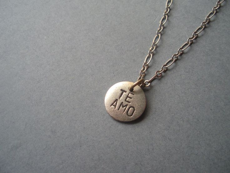 Te Amo, I love you in Spanish, hand stamped metal necklace, boyfriend girlfriend, anniversary gift, for her, for him, wonderkath. $17.99, via Etsy.