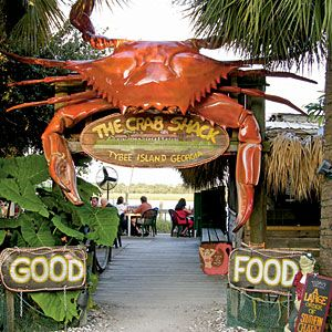 Visit the Crab Shack near Tybee Island, Georgia where you eat low country boil outside overlooking the water and cats hang around waiting for the delectable leftovers. www.thecrabshack.com