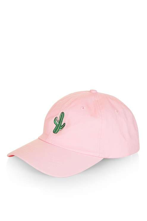 Caps are key this season. Embrace the trend with an unstructured fit and fun embroidery details. Crafted in a soft pink cotton, this simple cap comes detailed with a cactus motif to the front. We're styling ours with this season's denim and a bomber jacket to finish the look. #Topshop