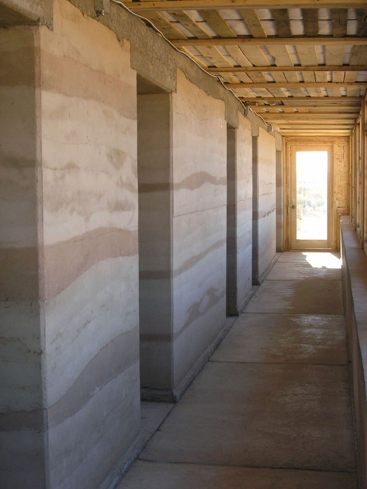 Beautiful example of rammed earth.  Also see banded plaster rammed earth veneers  pigment color these stripes before plastering in bold earth tones colors