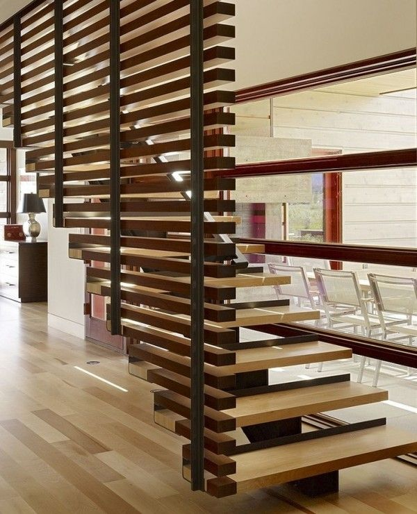 Love the look of the stained wood pieces stacked floor to ceiling.
