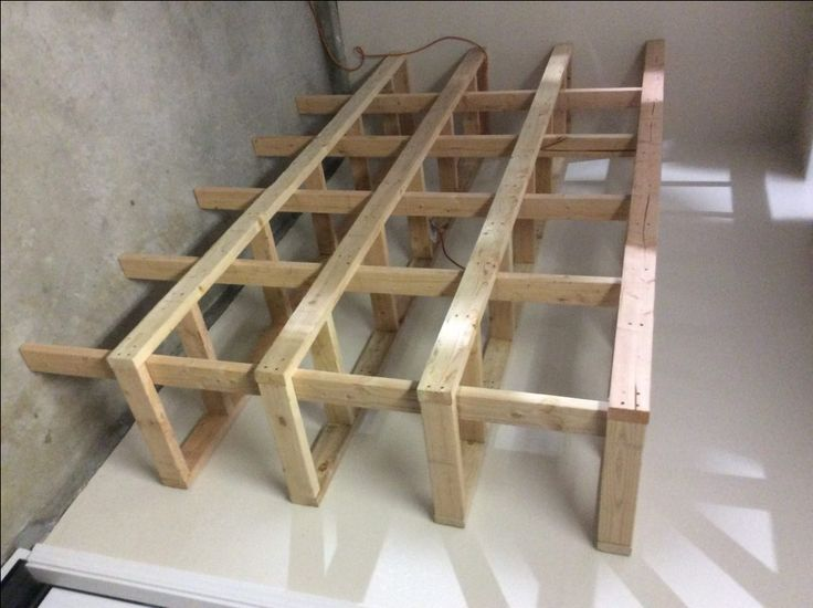 DIY garage shelving unit made from dimensional lumber and designed for  economy and no waste!