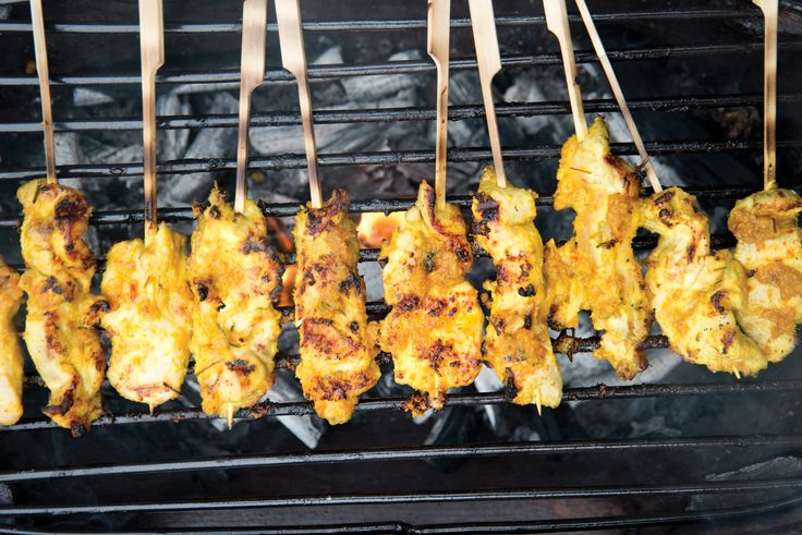 Our chef's own Chicken Satay taking on delicious smoky flavours cooked on our Acapulco Terracotta bbq - recipe at www.wheelandbarrow.com.au