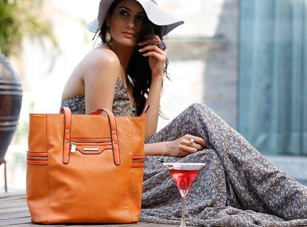Indian woman flaunting handbag
