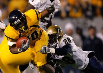 """Steve Slaton Kevin C. Cox/Getty Images  Steve Slaton, 5'10"""" 190 lbs., gained 3,925 yards rushing on 664 carries for an average of 5.9 per carry for his career at WVU. He also scored 55 TDs."""