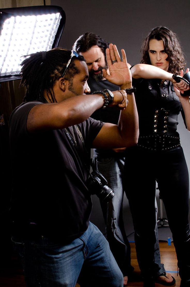 Qu Griffin gives combat pose advice to actress, Erin Elizabeth Reed while actor, Patrick Sane assists her with wardrobe at PDL Studios, 2012 in Houston, Tx. Photo taken by Sanjay N. Patel - sanjaynpatel.com  Erin Elizabeth Reed Film Credits: http://www.imdb.me/erinelizabethreed  Patrick Sane Film Credits: http://www.imdb.me/patricksane  Qu Griffin Film Credits: http://www.imdb.me/qugriffin