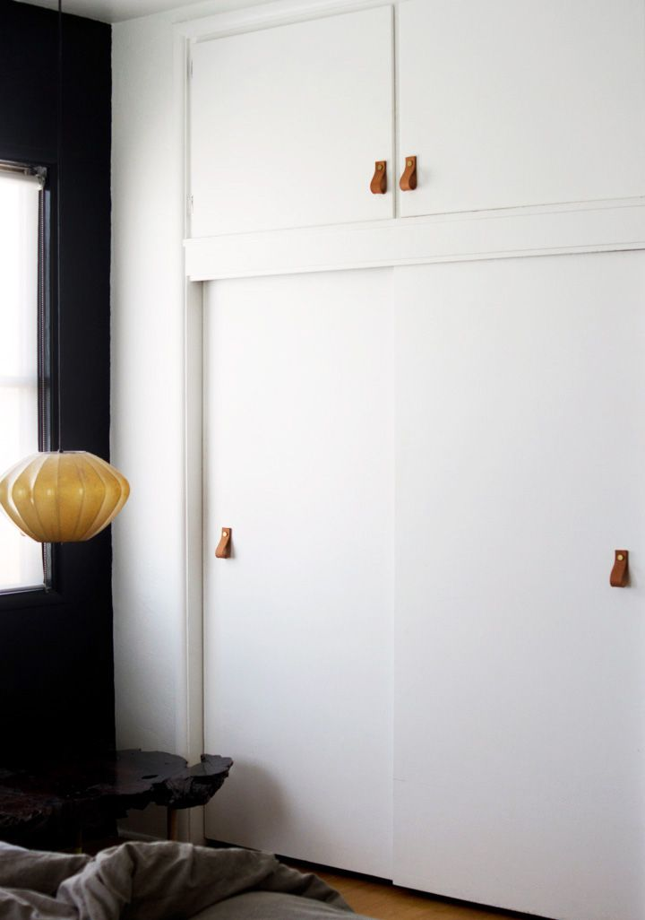 leather pulls on built-in closets give a modern-rustic twist to a room