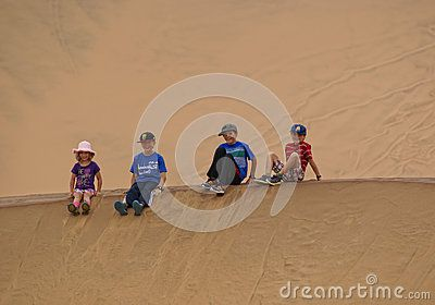 Children Sitting On A Dune - Download From Over 31 Million High Quality Stock Photos, Images, Vectors. Sign up for FREE today. Image: 52748359