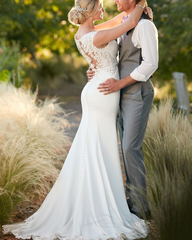 We love how this sleek wedding gown from @essenseofaustralia elongates the body. SO gorgeous! The back is  #backlessdress  #modernweddingdress #lace  #weddingdressshopping #weddinggown #weddingdress #ftbboutique #bridalfashion #bridalstyle #engaged #ftmyersbridalshop #ftmyersbridalboutique #ftmyerswedding #AllureBridals #EssenceOfAustralia #MaggieSottero #CallaBlanche #farage #VenusBridal #ftmyers #naples Sent via @planoly #planoly