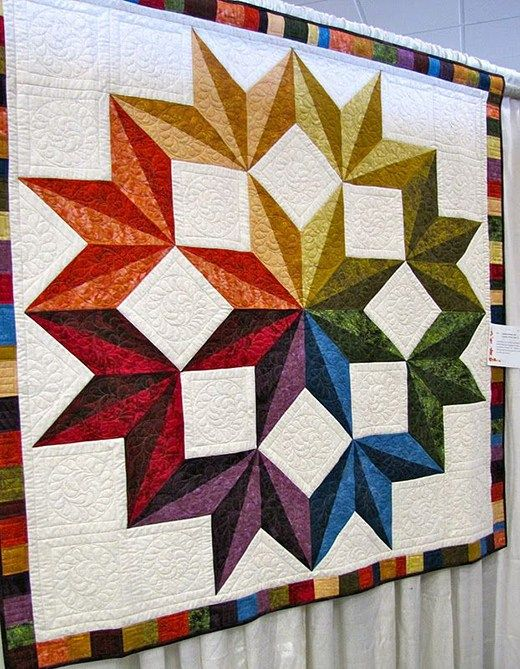 This Quilt pattern is made up of squares and half square triangles. The overall design is a large star pieced together like inlaid wood. You can grab the free pattern via this PDF file.