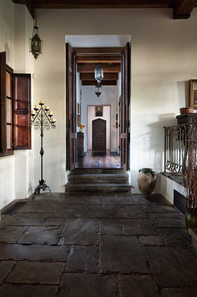 stone floor, rustic, Spanish design. Love the floor and the door and the window and the stairs.