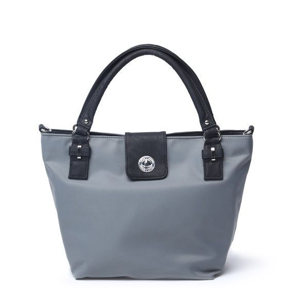 Saratoga by Kelly Moore, a lightweight but sturdy bag for traveling photographers. I bought the pretty bluish grey! There's a removable cushioned basket for camera gear and interior pockets for accessories.