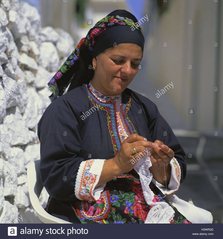 Greece, cirque emotionalism, Olympos, woman, crochet, clothes, traditionally, portrait, outside, Greek islands, Dodekanes, locals, Greek, sit, manual labour, manual labours, hobby, headscarf, blouse, jacket, embroiders, national costume, national national costume  Contributor: mauritius images GmbH / Alamy Stock Photo