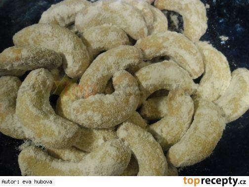 Vanilkové rohlíčky bez ořechů200 g hladké mouky 50 g moučkového cukru 1 žloutek 120 g tuku cukr moučka a vanilkový cukr na obalování