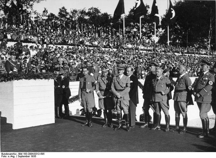 Rudolf Heß, Adolf Hitler, and Julius Streicher at a Nazi Party rally, Nürnberg, Germany, 10-16 Sep 1935