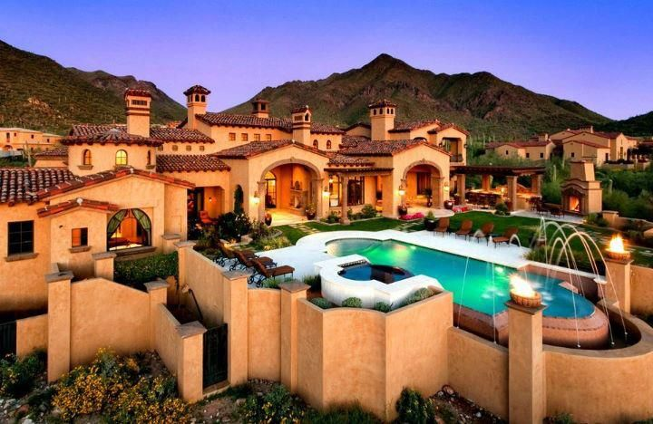If the house was white, it would look even more incredible and add flowers to it for a finishing touch.  Incredible how big that pool looks.