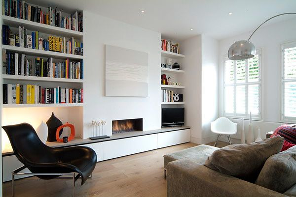 Shelving in recess next to fireplace