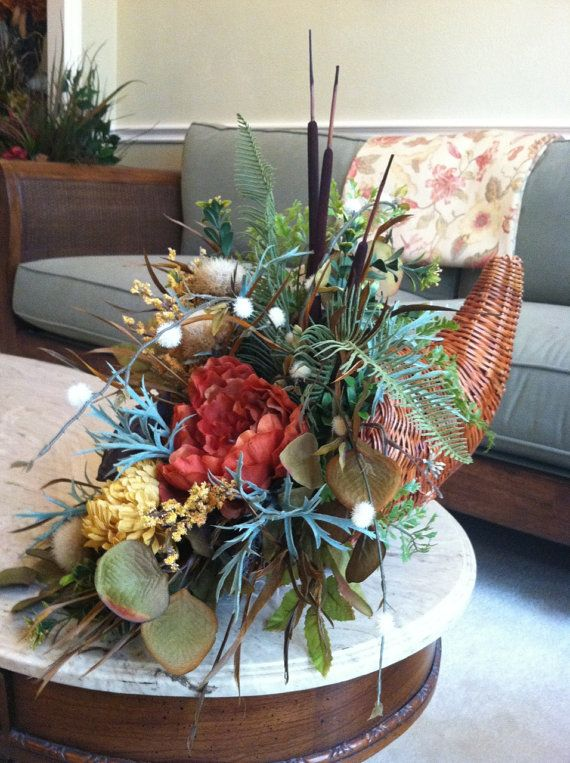 Thanksgiving centerpieces and silk floral arrangements on