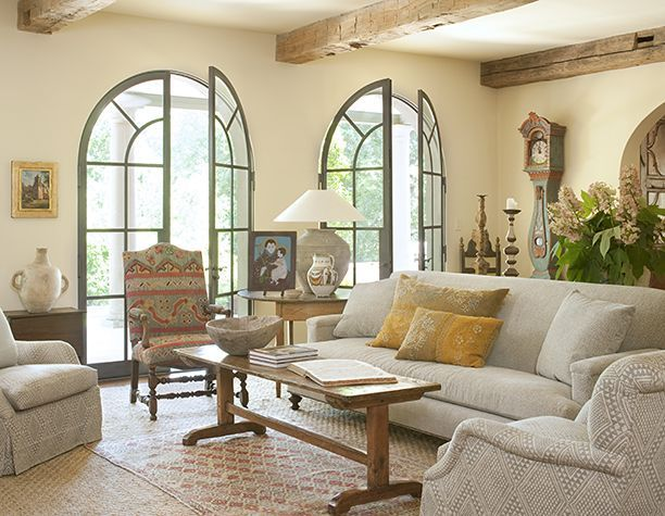 European Warmth And Style Conveyed Through Beautiful Arched Doors The Natural Beamed Ceiling A