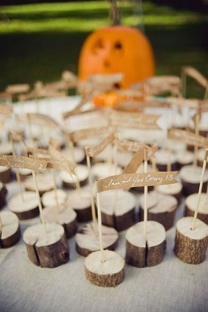 Placecard holders. Definitely thinking about doing this! Lots of wood laying around we could use.