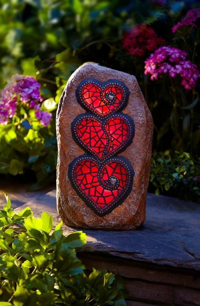 A solar-powered LED bulb illuminates the three mosaic hearts in this garden light. It's an accent piece that will help light a path or favorite spot in your yard or garden.