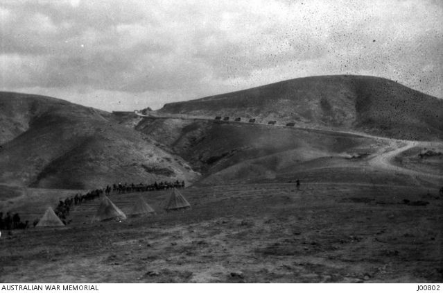 Road near Talat Ed Dumm.  At the top of the road is the Inn of the Good Samaritan. The Camel Corps Field Ambulance in the left centre is going for water. Ottoman Empire: Palestine, Talat ed Dumm,1918