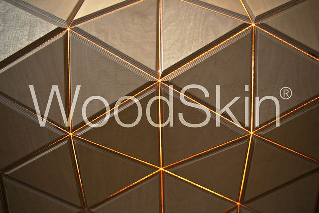 WoodSkin by MammaFotogramma. Woodskin® is a composite material, developed and patented by our design firm. This highly flexible surface – a sandwich wood and high-tech mesh – was created by a process of excavation with a CNC cutting machine. .