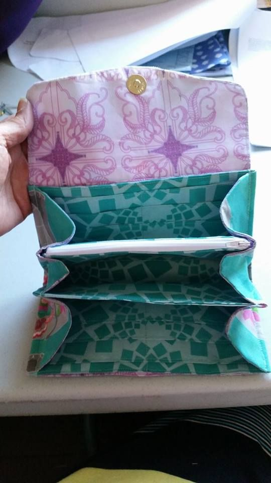 inside view of ladies Clutch/Wallets  zippered pocket, 12 CC slots, 2 compartments & 2 unzippered pockets behind CC slots     Email: mbmaccessories1@gmail.com Facebook:  https://www.facebook.com/mbmaccessories1