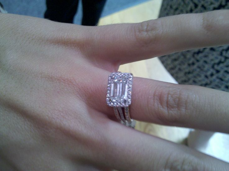 horizontally set emerald cut diamond engagement ring with pave halo. shown with 2 pave eternity bands