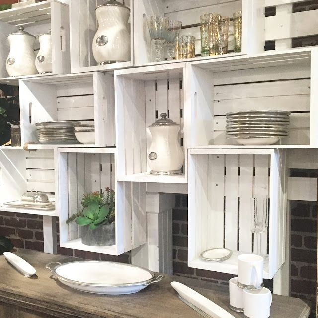 Basic wood crates painted white and hung on wall for kitchen organization