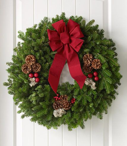 L.L.Bean's Traditional Balsam Wreath: Made with approximately 4 pounds of balsam greenery. Adorned with real pinecones, silvery faux-reindeer moss and faux crab apples and holly berries. Weather-resistant red bow. Includes a convenient over-the-door hanger. Made in Maine and shipped for free.