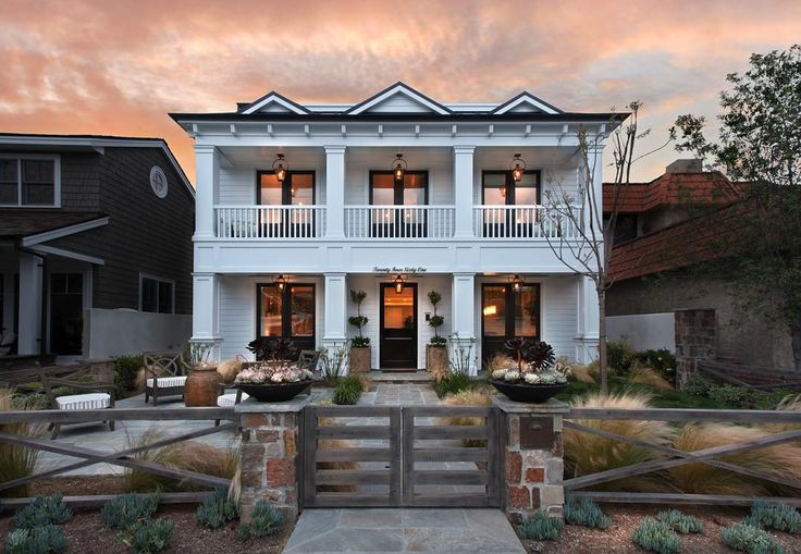 Beautiful traditional Colonial/Greek revival design with ample indoor and outdoor living spaces. (builder @pattersoncustomhomes   photo @jkoegel)