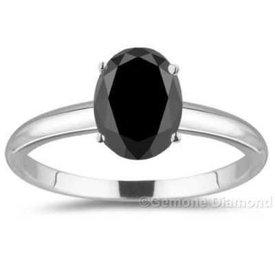 The ring has centre stone as the huge 1 carat oval brilliant cut natural black diamond of the finest quality.